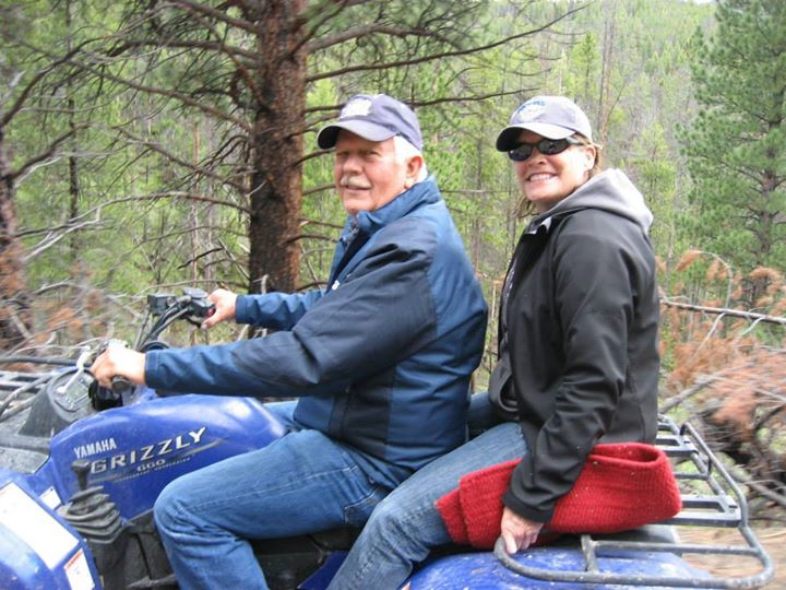 Photo of couple on a Yamaha Grizzly four wheeler