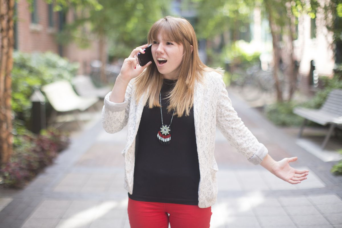 Frustrated business casual female on phone