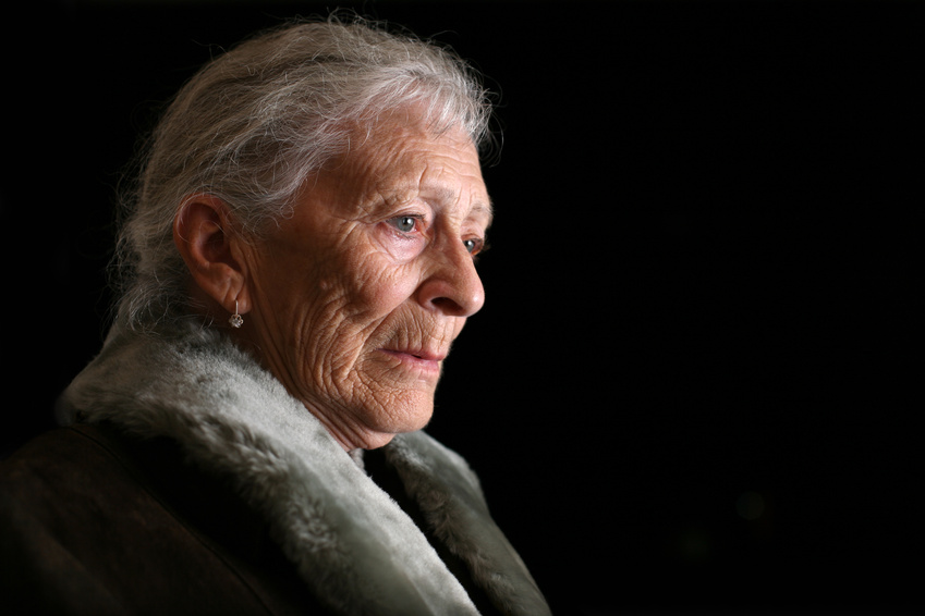 Photo of contemplative senior woman