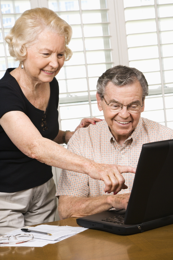 Senior couple working on laptop